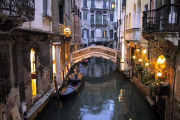Veneto - A romantic view of Venice with a gondola, the Venetian rowing boat